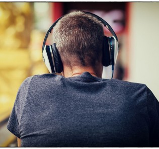bigstock-the-man-and-his-big-headphone-84098339