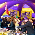 Fans enjoying a tailgating tent at LSU.