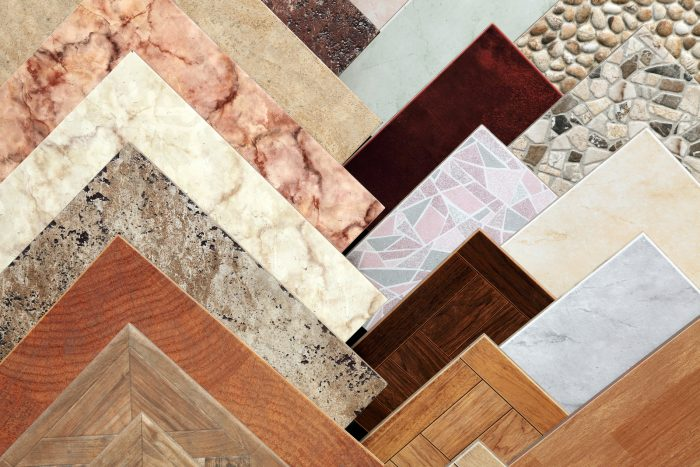Samples of a ceramic tile in layered side by side ranging in color and design.