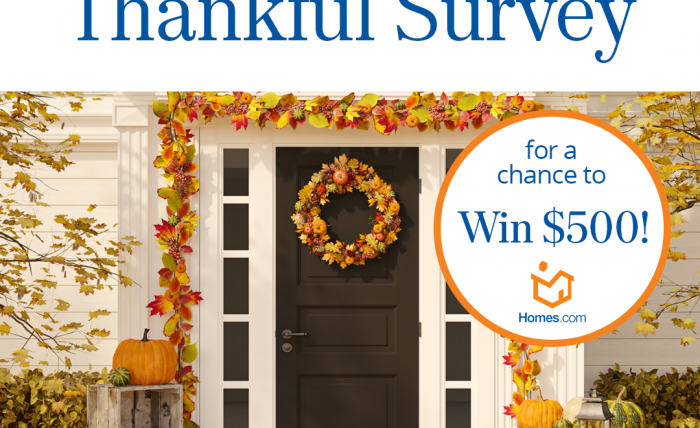 """A image of a fall staged porch with the phrase """"enter the homes.com thankful survey for a chance to win $500."""""""