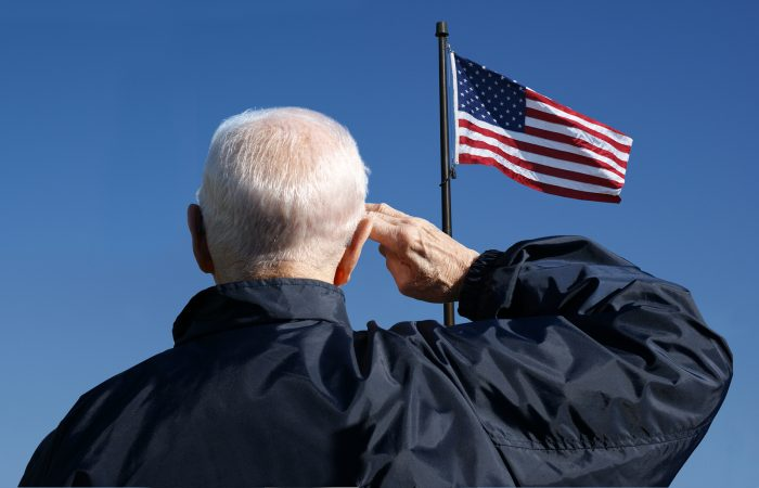 View of a veteran saluting the flag of the United States.