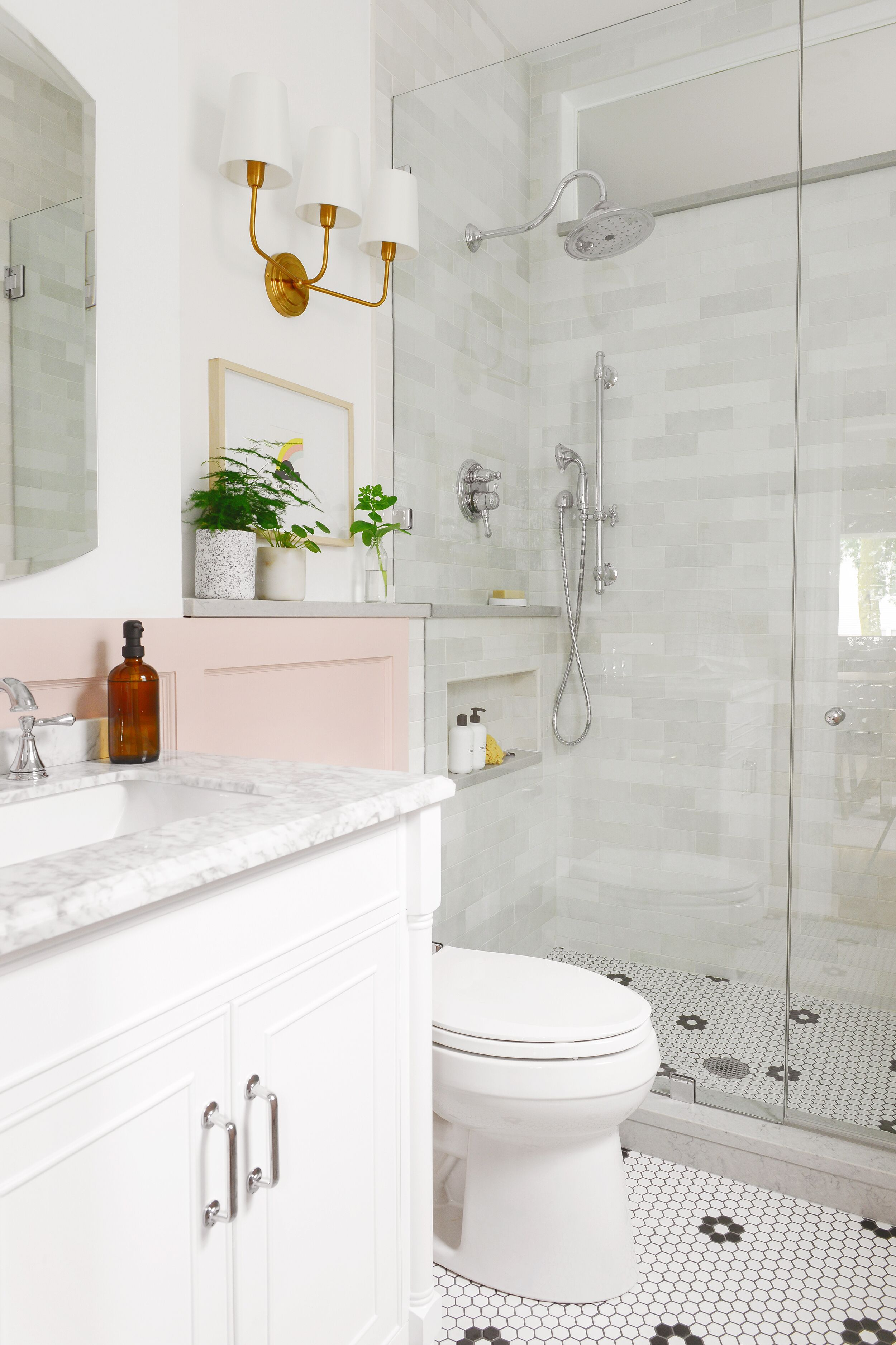 Bathroom with pink accent cabinet