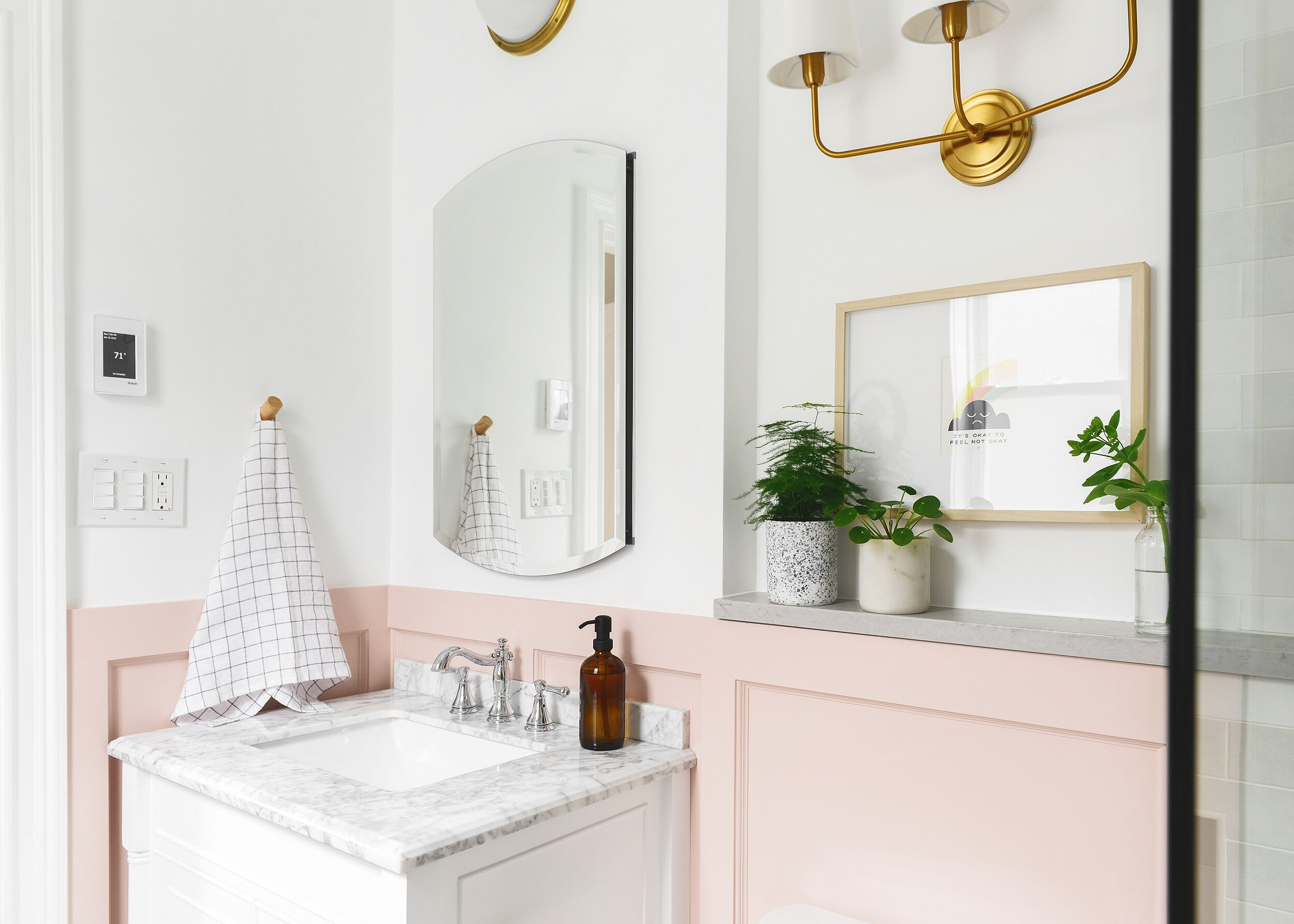 Bathroom with pink accent cabinets