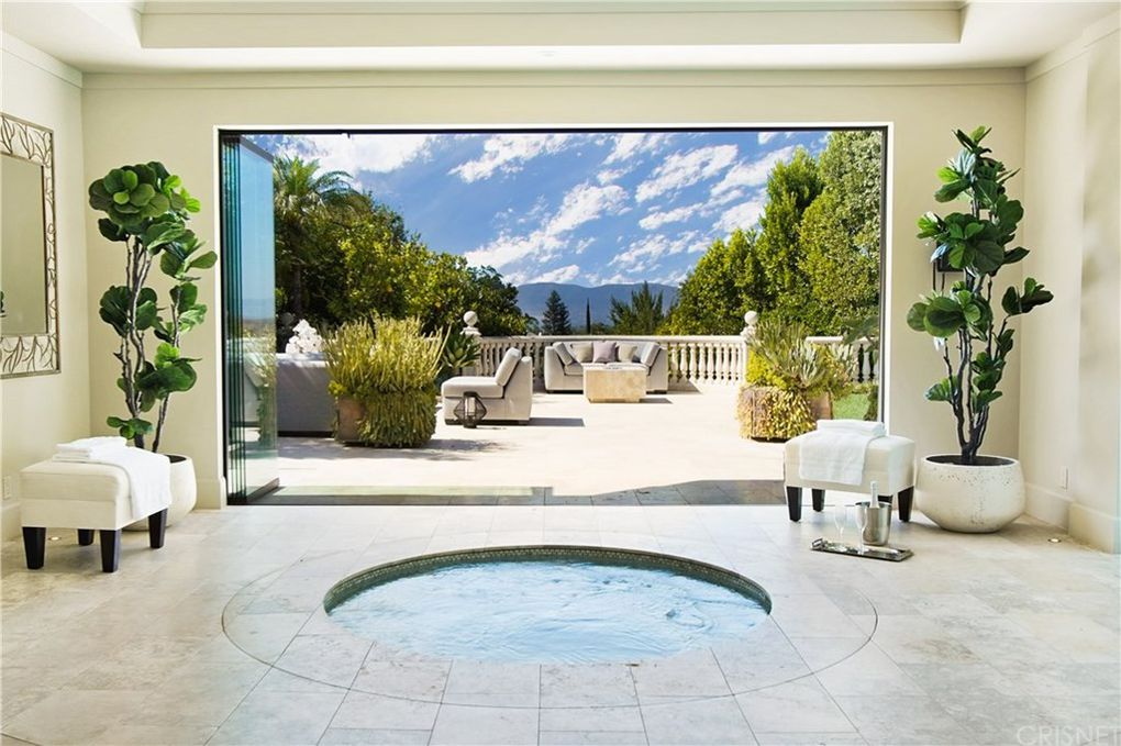 indoor circular jacuzzi with views of California's mountains