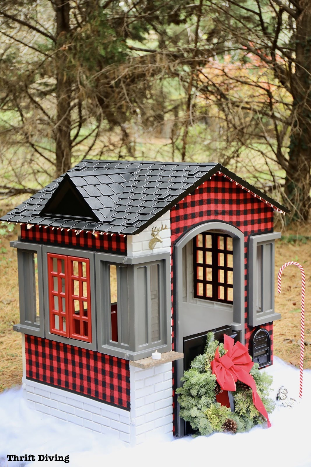 little tikes cape cottage playhouse decorated with flannel fabric, a wreath, and black roof