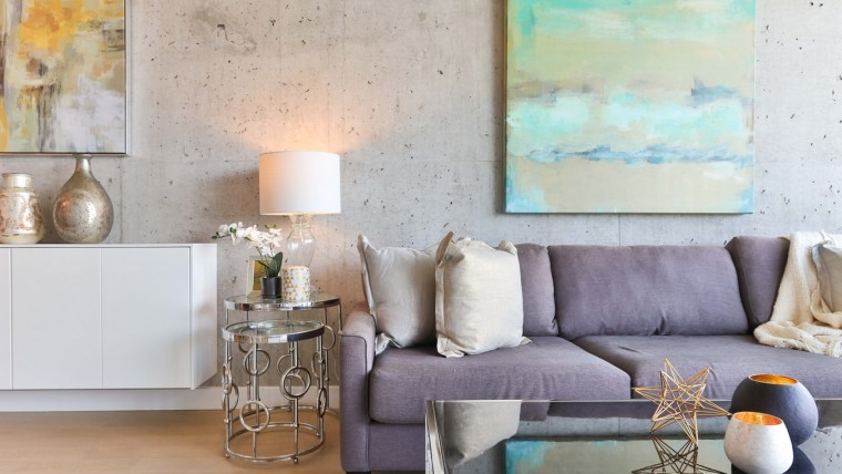 living room with light purple couch and metal accents