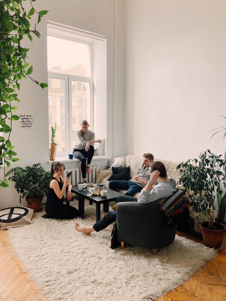 group of young college students hanging out at home