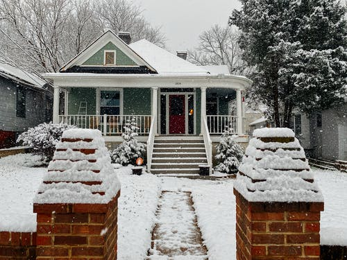 winter proof your home protect it from the cold weather house covered in snow