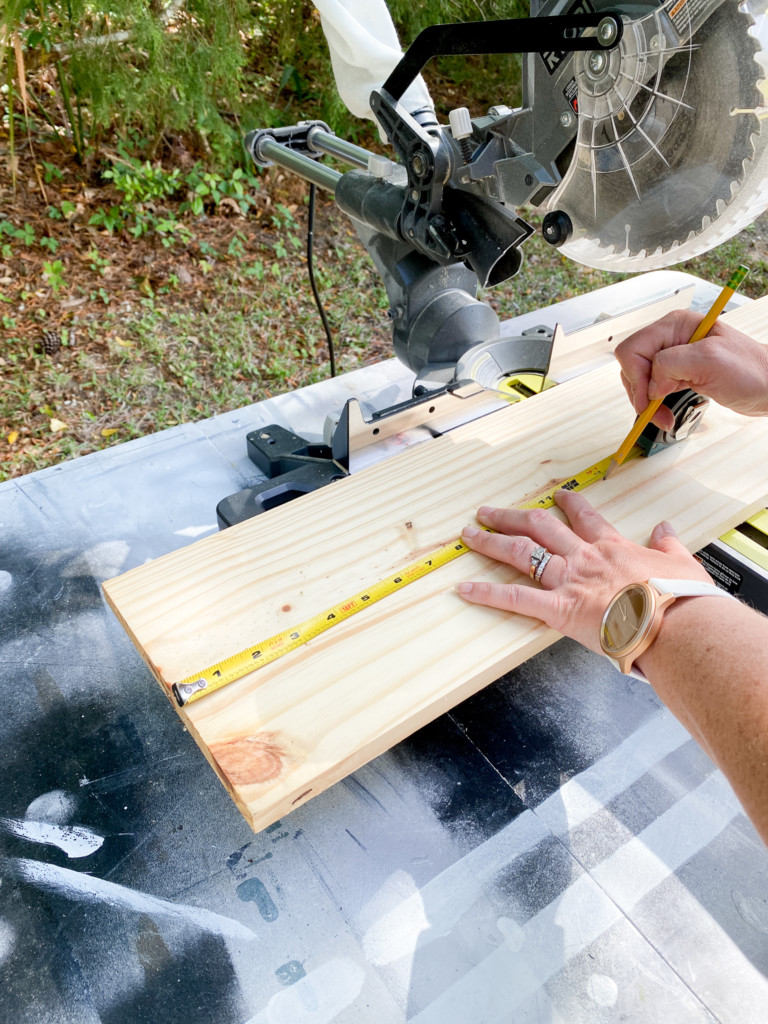 Measuring an 8 inch wide board to be cut on larger sliding miter saw.